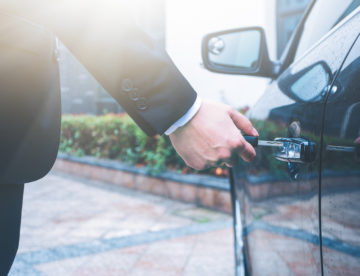 Image depicting business man locked out of his car